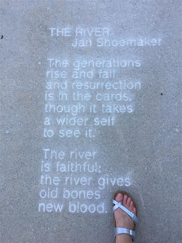 "Jan's poem ""The River"" which is inscribed in the sidewalk in Lansing's Old Town"