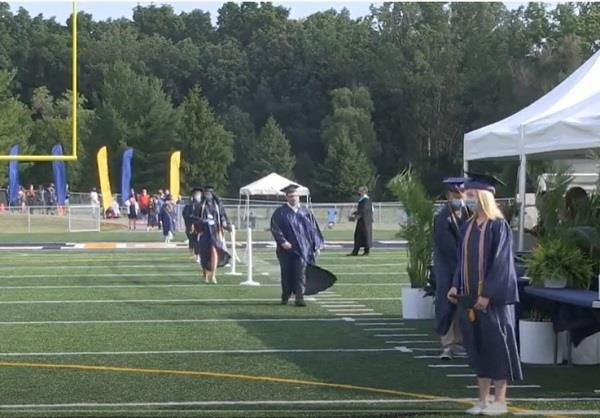 Graduates accept their diplomas at the Haslett High School graduation ceremony.