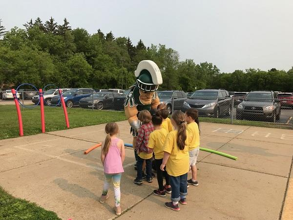 Photo: Sparty visits with Wilkshire students.
