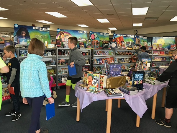 Students look through the offerings at the Murphy book fair.