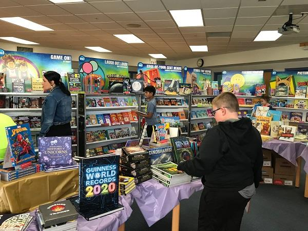 Students shop at the book fair.