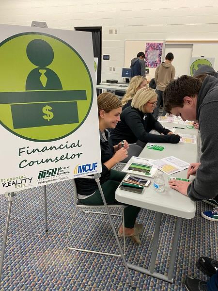 Students learn about budgeting at the financial reality fair.