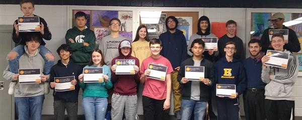 High School students show off their Microsoft certifications.