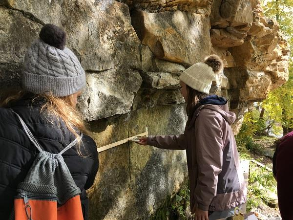 High school students take rock measurements.