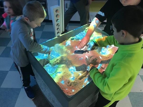 Students experience a 3D sandbox.