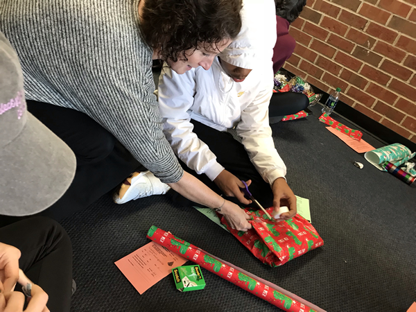 Mrs. Vessel's students wrap gifts for those in need.